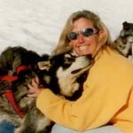 Melanie Tucker in dogsled camp in Alaska