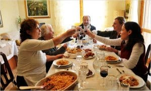 Dine with locals in Italy.