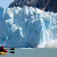 paddling by glacier off Uncruise boat in Alaska