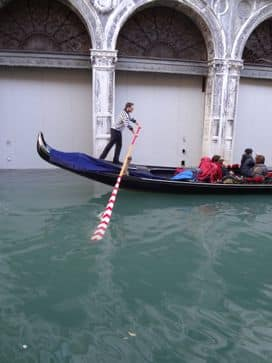 gondolier by Bridge of Sighs Venice Italy
