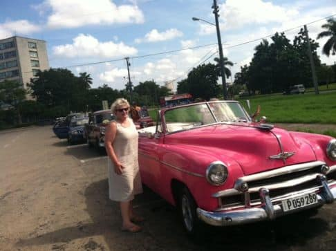Bambi with old car in Cuba