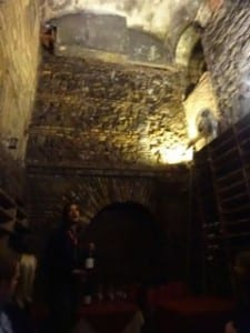 basement wine cellar shows centuries of the city on its walls Italy