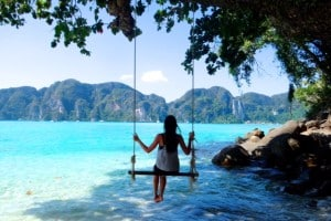 swinging on the beach in Phi Phi Thailand
