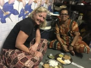 My host Mom for dinner in Dharavi,in India