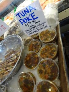Tuna Poke is one of many choices at the fishmonger stalls of Seattle's Pike Place Market